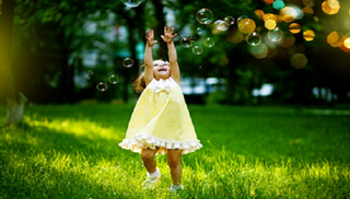 Pure JOY! Chasing bubbles and laughing with her